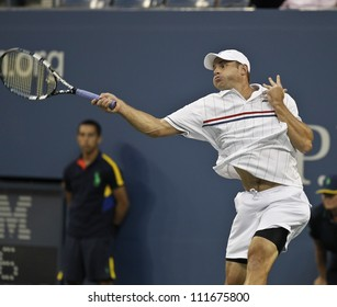 NEW YORK - AUGUST 31: Andy Roddick of USA returns ball during 2nd round match against Bernard Tomic of Australia at US Open tennis tournament on August 31, 2012 in Flashing Meadows New York