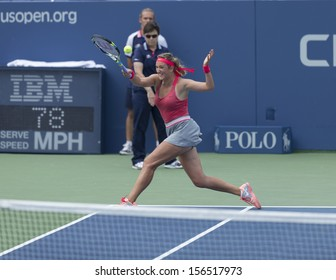 NEW YORK - AUGUST 31: Victoria Azarenka of Belarus returns ball during 3rd round match against Alize Cornet of France at 2013 US Open at USTA Billie Jean King Tennis Center on August 31, 2013 in NYC
