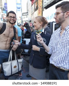 NEW YORK - AUGUST 5: Morgan Wilber of Guinness World counts participants of National Underwear Day during attempt of breaking Guinness world record on Times Square on August 5, 2013 in New York City