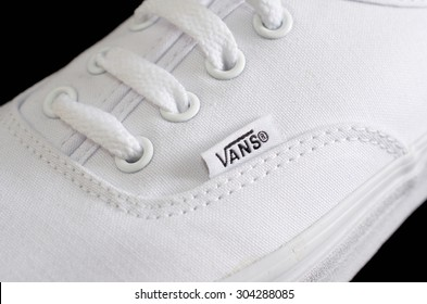 NEW YORK - AUGUST 8, 2015: White Vans (Off the Wall) sneaker isolated on black