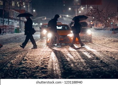 New York, Brooklyn / United States - November 15th 2018: A traffic light being blown by the snowstorm's wind