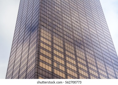 New York building with sky and clouds on background.