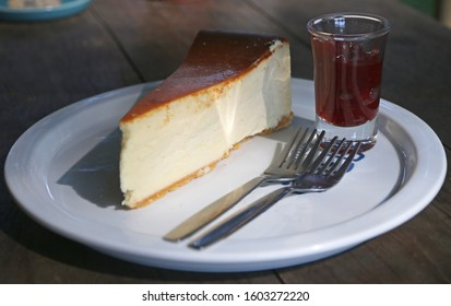 New york burnt cheesecake homemade style serve with strawberry syrup