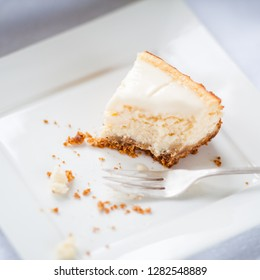 New York cheesecake, has base with crushy cakes, cheese in middle and sour glaze at top