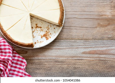 New York cheesecake on wooden background or food background with cheesecake. Top view and copy space for text