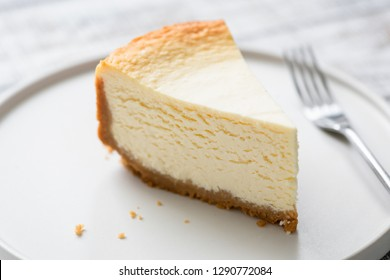 New York Cheesecake Slice On Plate. Closeup view. Tasty smooth cheesecake