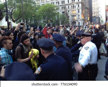 NEW YORK - CIRCA 2011: Unidentified Occupy Wall Street protesters march to protest in New York City, NY. Protests spawning the movement against economic inequality worldwide. Clash with NYPD police