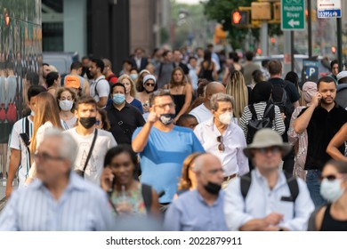 NEW YORK - CIRCA AUGUST 2021: Crowd of people walking street during Covid 19 reopening