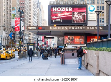 New York, circa dec 2014: People walk in front entrance of madison square garden in manhattan
