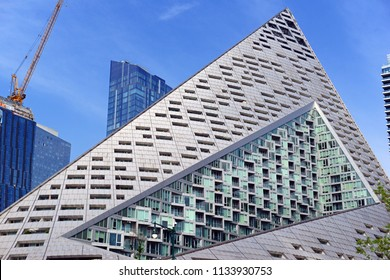 NEW YORK CIRCA JULY 2018. The west side of Manhattan pictured here has seen heavy commercial and residential development such as modern apartment buildings such as this pyramid shaped design