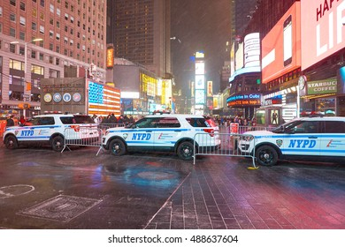 NEW YORK - CIRCA MARCH, 2016: NYPD cars in Manhattan at night. The New York City Police Department (NYPD or NYCPD) is the largest municipal police force in the United States.