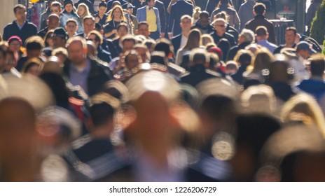 NEW YORK - CIRCA NOVEMBER 2018: Crowd of people walking street