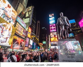New York - Circa OCT 2014: Statue of famed showman George M. Cohan and huge outdoor billboards promoting Broadway musicals in Times Square
