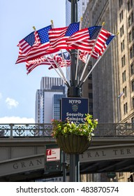 NEW YORK - CIRCA SEPTEMBER 2016: NYPD security sign and American flags