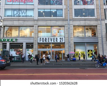 New York City - 1 October 2019: Exterior facade of Forever 21 on 14th Street, Manhattan, New York City. View of Forever 21 from across the street. People walking in front of Forever 21 retail store.