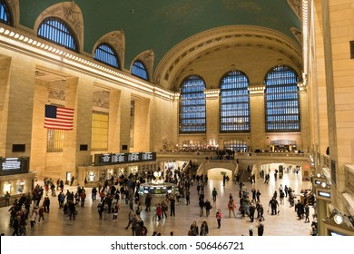 NEW YORK CITY - 1 OCTOBER 2016: Inside Grand Central Station in New York.  Iconic architecture from the golden age of train travel.  American flag hands above the entrance.