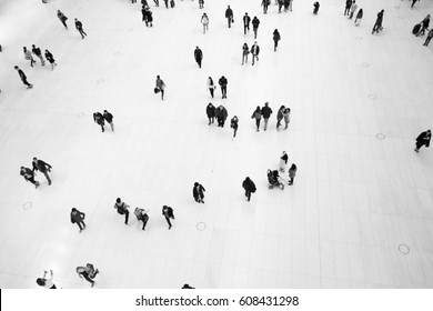 NEW YORK CITY - 1 OCTOBER 2016: Bird's eye view of people walking through the interior of The Oculus by architect Santiago Calatrava.Black and white photography.