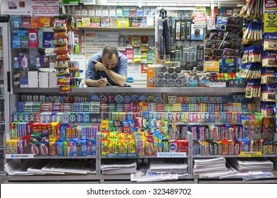 New York City, 10 september 2015: vendor in new york city lower manhattan kiosk on wall street