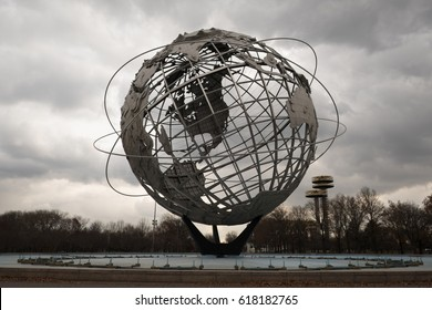 New York City - 12 December 2016: The Unisphere and fairgrounds of the 1964 New York World's Fair in Flushing Meadows Corona Park, Queens, New York, observation towers in the background.