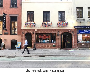 NEW YORK CITY - 12 JULY 2016: A businessman walks in front of the Stonewall Inn on Christopher Street, the location of the Stonewall riots and the birth of the gay rights movement.