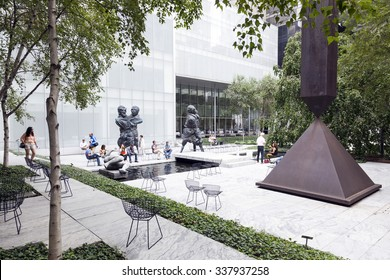 New york city, 12 September 2015: Visitors sit and walk in Sculpture garden of Moma New york city