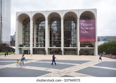 new york city, 12 september 2015: people walk on square in front of metropolitan opera at lincoln centre in new york city