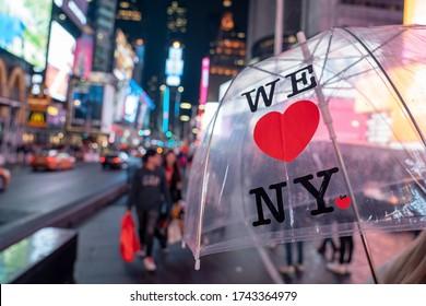 """New York City, New York - 15 May, 2019:  An umbrella with """" I Love NY"""" logo text. Symbol of New York."""