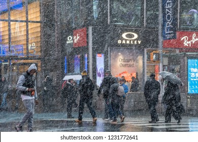 New York City, New York - 15 November, 2018: First snowfall in New York. It has heavy snow storm. People are crossing the street