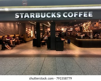 New York City - 16 July 2017: Starbucks Coffee shop inside Penn Station in New York. People having coffee inside Starbucks at Pennsylvania Station in Midtown Manhattan.