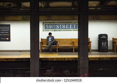 New York City 18th September, 2012: man waiting for the subway train at night, 59th street subway stop in Manhatten