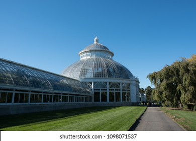 New York City - 20 October 2017: Exterior of the Enid A. Haupt Conservatory greenhouse at the New York Botanical Garden in the Bronx on a cloudless autumn day.