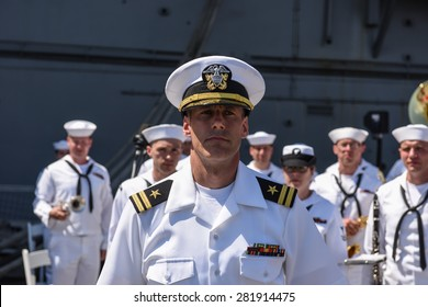 NEW YORK CITY - 25 MAY 2015: Mayor Bill de Blasio & Gen John Kelly presided over Memorial Day observances on Pier 86 by the USS Intrepid. US Navy band at attention
