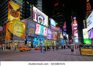 NEW YORK CITY -26 JAN 2018- Night view of the busy Times Square at the intersection of Broadway and 7th Avenue in Manhattan with giant billboards and musical theaters.