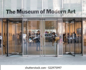 New York City - 30 April 2016: Revolving glass doors of the main entrance of MoMA in midtown Manhattan.