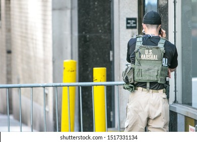 New York City, 9/27/2019: US marshal is talking on the phone while deployed to a police checkpoint near the UN headquarters Manhattan during General Assembly.