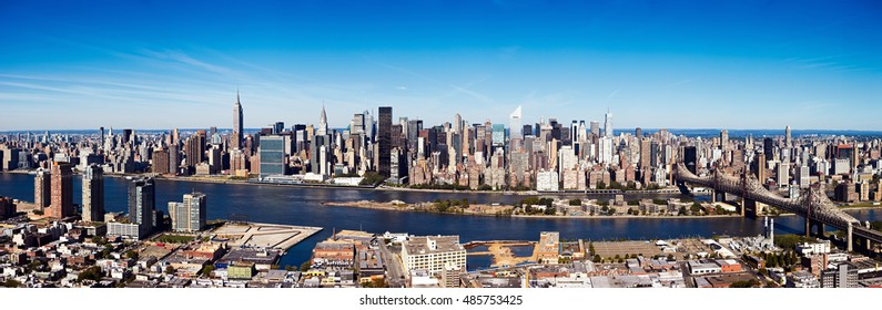 New York City Aerial Skyline Panorama showing the east side of midtown Manhattan, taken from Queens around April 2012. This is a cylindrical projection created from 7 stitched images.