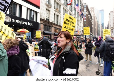 NEW YORK CITY - APRIL 1 2017: Nearly one hundred activists organized by People's Power Assembly rallied in Herald Square to demand justice for people of color at the hands of law enforcement