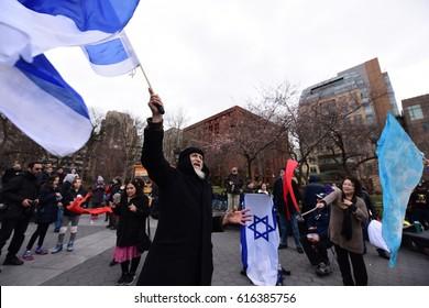 "NEW YORK CITY - APRIL 1 2017: A dozen Messianic ""Jews"" rallied at Washington Square Park on April Fools' Day to wave Israeli flags & blow shofar. Messianic ""Jews"" accept Jesus Christ as Messiah,"