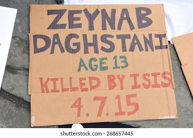 NEW YORK CITY - APRIL 10 2015: activists gathered in Bryant Park for a rally & march to Dag Hammarskjold Plaza in support of residents of the Yarmouk refugee camp in Syria under siege by ISIS fighters