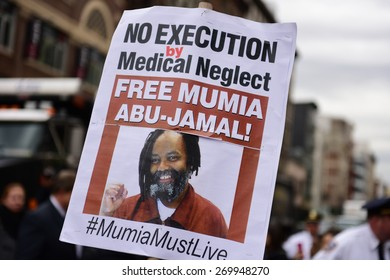NEW YORK CITY - APRIL 14 2015: several hundred activists from Stop Mass Incarceration Network rallied at Union Square Park before marching to Lower Manhattan. Mumia Abu Jamal poster