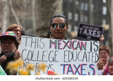 """NEW YORK CITY - APRIL 15 2017: Thousands turned out for a """"Tax Day"""" rally at Bryant Park & a march to Trump Tower demanding the President release his taxes."""