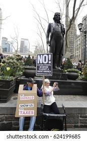 NEW YORK CITY - APRIL 15 2017: Thousands rallied at Bryant Park before marching to Trump Tower demanding the President release his taxes.