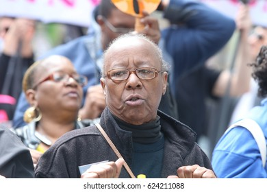 """NEW YORK CITY - APRIL 15 2017: Thousands turned out for a """"Tax Day"""" rally at Bryant Park & march to Trump Tower demanding the President release his  taxes. The Black Institute Bertha Lewis"""