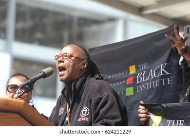 """NEW YORK CITY - APRIL 15 2017: Thousands turned out for a """"Tax Day"""" rally at Bryant Park & march to Trump Tower demanding the President release his  taxes. Black Institute founder Bertha Lewis"""