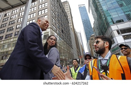 """NEW YORK CITY - APRIL 15 2017: Thousands turned out for a """"Tax Day"""" rally at Bryant Park & march to Trump Tower demanding the President release his taxes. Hakim Jeffries & Sarah Silverman arrive."""