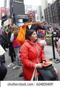 NEW YORK CITY - APRIL 15 2017: Sikhs of New York arranged for Turban Day in Times Square where Sikhs & their supporters were helped to put on turbans.