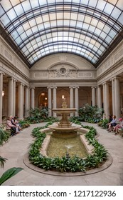 NEW YORK CITY - APRIL 17, 2016: people rest in the atrium of the Frick Collection, former 5th Avenue mansion of steel magnate Henry Clay Frick.