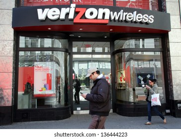 NEW YORK CITY - APRIL 19: People walk past a Verizon Wireless retail outlet in New York City, on Friday, April 19, 2013.