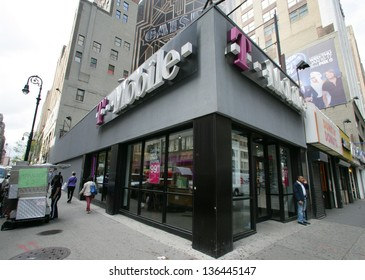 NEW YORK CITY - APRIL 19: Pedestrians walk past a retail outlet for T-Mobile in New York City, on Friday, April 19, 2013.