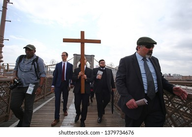 NEW YORK CITY - APRIL 19 2019: The Diocese of Brooklyn-Queens staged it annual Good Friday Way of the Cross procession across the Brooklyn Bridge to Ground Zero.